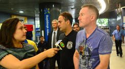 Michael Lynn being escorted through Recife's international airport