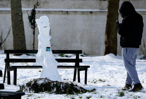 A snowman on a bench in Dublin Photo: PA