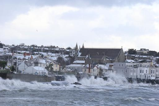 Waves crash against the shore at the Forty Foot in Sandycove, Co Dublin. Photo: Collins