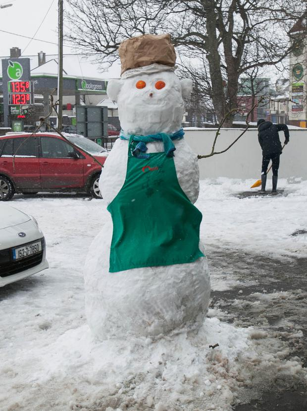 A snowman outside Macaris takeaway in Clondalkin, Dublin. Photo: Gareth Chaney