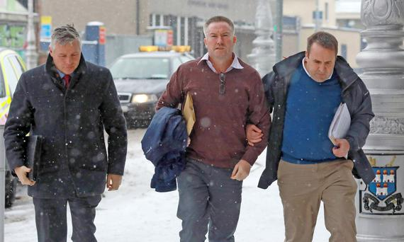 Michael Lynn (centre) arriving at the Criminal Courts of Justice Photo: Paddy Cummins/PCPhoto.ie