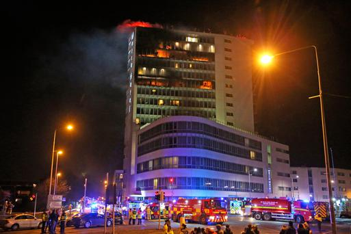 Firefighters tackle the fire at the Metro Hotel near Dublin Airport on the northside of the city. Photo: PA