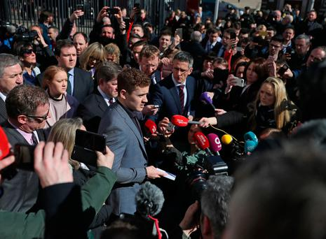 Paddy Jackson (centre) speaking outside Belfast Crown Court. Photo: PA