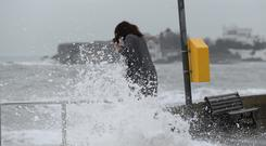 Larisa Tuaev, from Russia, gets battered by the waves at Sandycove, Co Dublin. Photos: Justin Farrelly