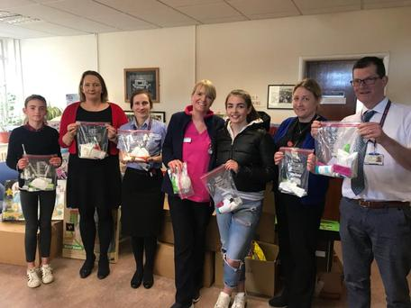 Rachel Casey (third from right) handing out grooming packages at Crumlin hospital