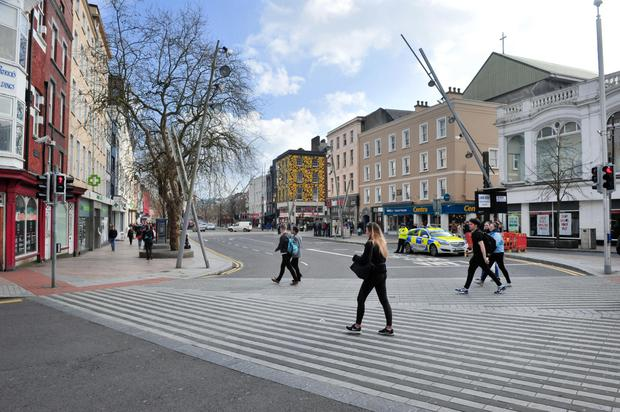 WALKING AWAY: St Patrick's Street in Cork is reportedly suffering from low footfall since the council restricted access for cars. Photo: Daragh Mc Sweeney/ Provision