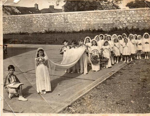 Pictured is Ritann Allen as Queen of the May in 1947. Nuala Barry is the second girl on the right holding the basket and with her hand up to her head and looking away