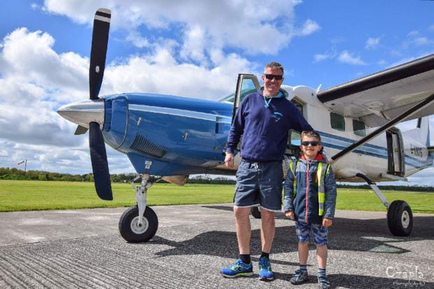 Seven-year-old Kacper Kacprzak and UK pilot Niall Bowditch Photo: GoFundMe