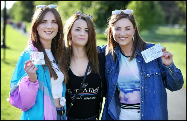 Anna Quinn, Orla Droney and Niamh Quinn, all from Blanchardstown, Dublin, make their way to the concert in the Phoenix Park. Photo: Steve Humphreys
