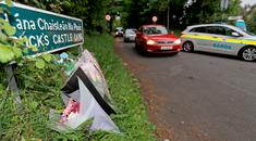 Flowers left at the scene in Rathmichael where the body of Jastine Valdez was found yesterday. Photo: PA/Donall Farmer