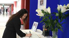 Isabelle Delaney Jones, student welfare officer at Tallaght IT, signs a book of condolences. Photo: Damien Eagers