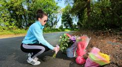 Abbey Russell places some flowers at the entrance to Powerscourt close to where Jastine Valdez was abducted. Photo: Gerry Mooney