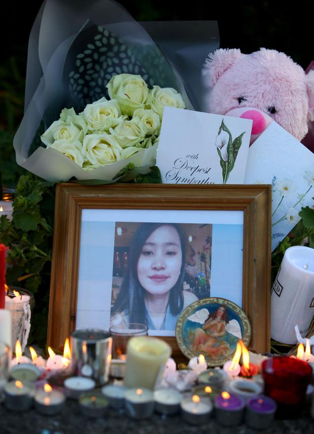 Candles and flowers surround a photograph of the murdered girl. Picture; Gerry Mooney