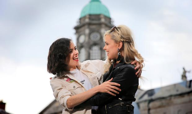A GENERATIONAL EXPLOSION: Sisters Jessica and Rachel Dowdall from Dublin were among the crowds who gathered in Dublin Castle to celebrate the Yes vote. Photo: Gerry Mooney