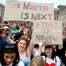 Yes campaigners at Dublin Castle hold signs calling for change in Northern Ireland. Photo: Getty
