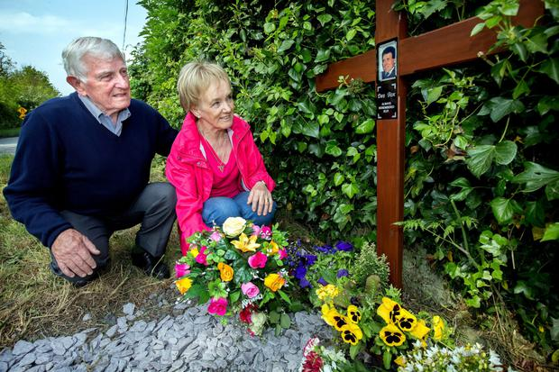 Brian and Bernadette Fox, the brother and widow of Dessie Fox, left, lay a wreath at the scene of his murder at Healy's Bridge near Prosperous, Co Kildare
