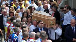 The remains of Bobby Messett are carried to the cemetery after his funeral Mass at St Mochonog's Church, Kilmacanogue, Co Wicklow, yesterday. Photos: Colin Keegan