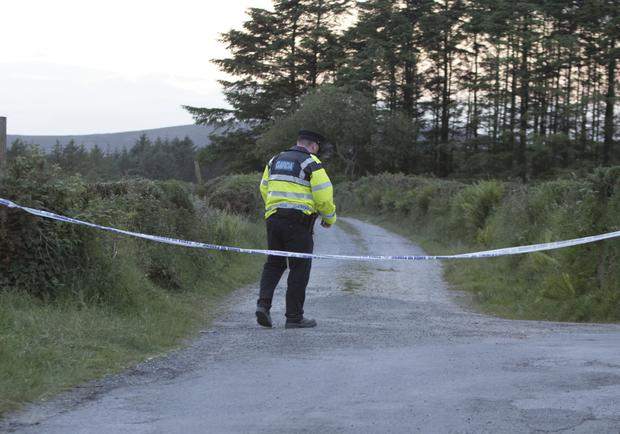 A garda closes off the road close to the scene where the secondary school student died last night.