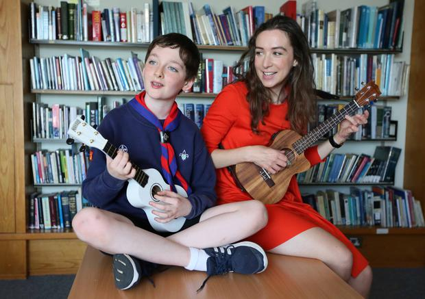 TOP ADVICE: Irish vocalist and songwriter Ríona Sally Hartman and scout Noah Carey (11) launch Dublin City Council's Cruinniú na nÓg programme. Photo: Stedman Photography
