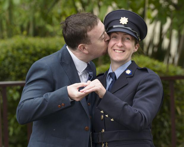 Karen Fitzpatrick from Artane, Dublin pictured with fiancé John Stapleton who proposed to her at her passing out ceremony at Garda College, Templemore, yesterday. Photo: Don Moloney/Press 22