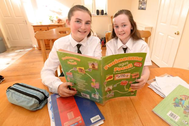 Shona Gogarty (11) and Rachel Arnold Martin (11), both fifth-class pupils at Mary Help of Christians Girls' National School in Dublin, who helped point out inequality in their Folens Irish workbook. Photo: Justin Farrelly