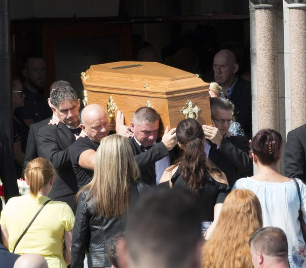 The coffin bearing stabbing victim Patrick 'Pa' O'Connor is carried from St Munchin's Church in Limerick following the funeral Mass for the 24-year-old yesterday