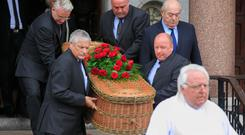 Left: Professor Martin O'Donoghue's remains are taken from the Church of St Paul of the Cross, Mount Argus, Harold's Cross, Dublin, yesterday. Photos: Gareth Chaney