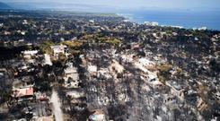 DEVASTATION: An aerial photo shows burnt houses and trees following a wildfire in Mati, east of Athens. Picture: AP