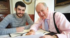 Independent presidential hopeful Gavin Duffy plans his campaign strategy with his son Lorcan. Photo: Seamus Farrelly