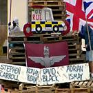 The names of four murdered police and prison officers are displayed on signs on the bonfire stack in the Bogside area of Derry