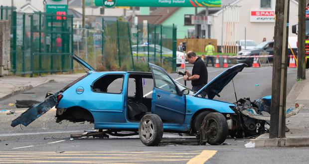 Gardaí on the site of a traffic accident where two people died and three were injured in Eastend, Bundoran, Co Donegal, yesterday early. Photo: PA