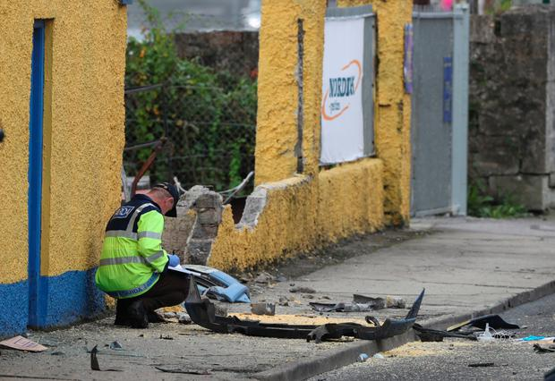 Gardaí at the scene of a road accident in which two people died and three were injured in Eastend, Bundoran, Co Donegal, early yesterday. Picture: PA