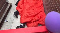 Family crisis: A father and son shelter beneath a sleeping bag just off Grafton Street in Dublin