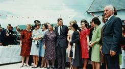 President Kennedy with distant Irish cousins on a visit to New Ross. Photo: Corbis/Getty