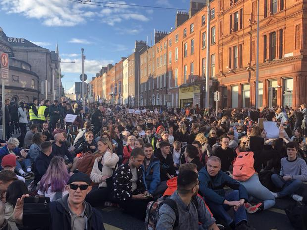 Protesters now sitting down at the top of O'Connell Street Photo: Amy Molloy
