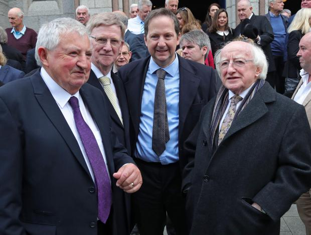 Former ministers Brendan Daly and Donie Cassidy with John Mulcahy's son, Michael, and President Michael D Higgins at the funeral in St Mary's Church, Haddington Road, Dublin. Photos: Collins