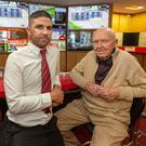 Have-a-go hero: Denis O'Connor and shop manager Tim Murphy at the Bar One betting shop in Hazelwood Shopping Centre, Glanmire, Co Cork. Photo: John Delea