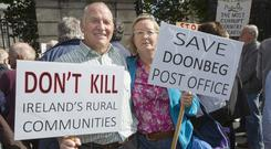 Posting message: Postmasters Alan Souter and Deirdre Hetherington from Doolin, Co Clare, on the march to the Dáil to protest the proposed post office closures. Photo: Tony Gavin