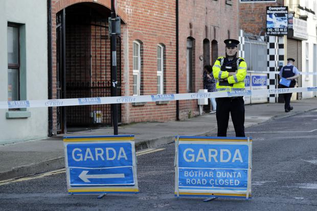 Crime scene: Gardaí outside the victim's home yesterday. Picture: Arthur Carron