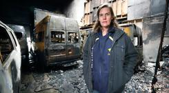 'Fire will affect 1,000 people': General manager Jo Heath surveys the damage to the four mini buses at the Lakers Special Needs facility in Bray, Co Wicklow. Photo: Frank McGrath