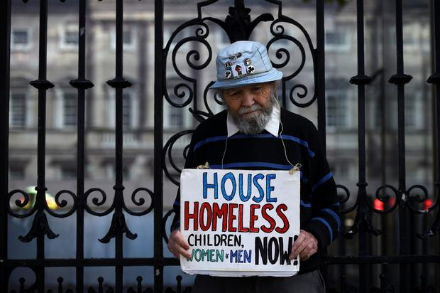 Appeal: A man holds a sign protesting against homelessness outside Government Buildings in Dublin. Photo: Clodagh Kilcoyne