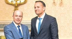 Seal of office: Denis Naughten and Taoiseach Leo Varadkar during an Appointment of Ministers Ceremony in 2017