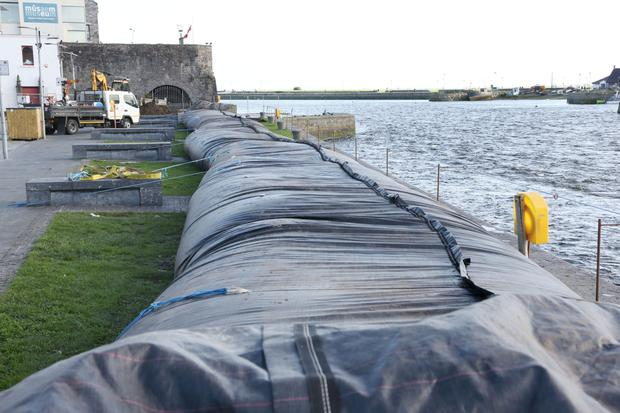 Galway city council installed a portable dam at the Spanish Arch in Galway City ahead of the storm. Photo: Andrew Downes