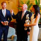 Influencers: Meghan Markle and Prince Harry received gifts for the new baby as they started their Australia tour in Sydney last night. Photo: PA