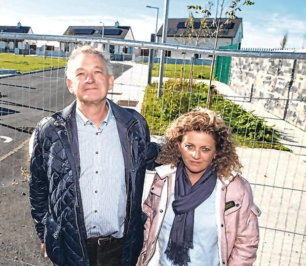 Peter Casey with his wife Helen at the controversial homes in Co Tipperary. Photo: Mark Condren