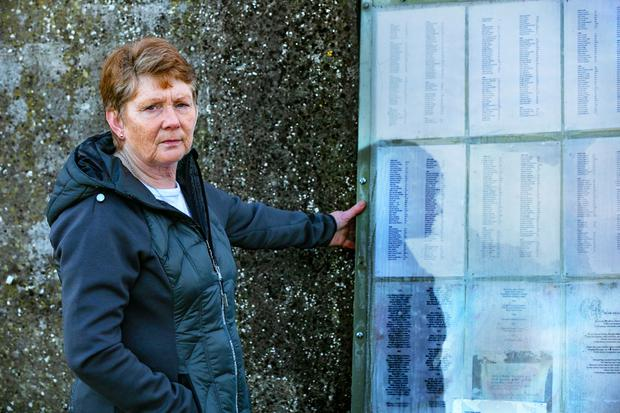 Historian Catherine Corless stands beside the list of children's names at the Tuam Mother and Babies site. Photo: Andy Newman