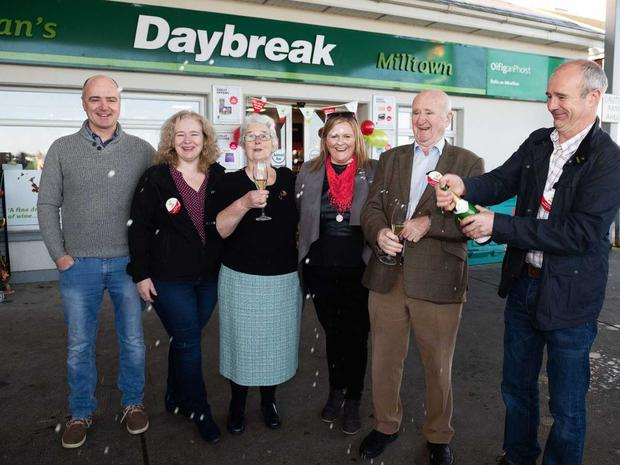 Staff and customers at Ryan's Daybreak store in Milltown, Co Galway celebrate after they sell a winning Lotto jackpot ticket worth €4,439,459 on Saturday 27th October.