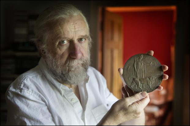FALLEN: Willie Kealy with the plaque that was given to every bereaved British Army family. Photo: David Conachypoint