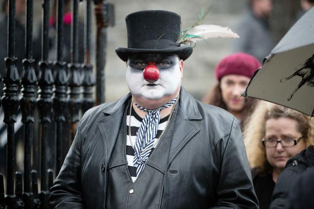 Mícheál Ó Súilleabháin's friend Simon, as Miko the Clown playing the part of a funeral director, at yesterday's funeral at St Senan's Church, Kilrush, Co Clare. Picture: Eamon Ward