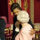 Michelle Obama puts her arm around Britain's Queen Elizabeth II at a reception at Buckingham Palace, London.